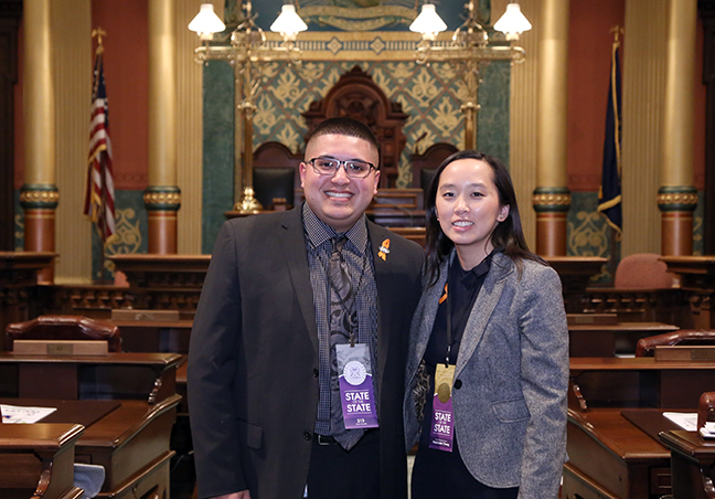 State Rep. Stephanie Chang (D-Detroit) attends the 2018 State of the State address at the Michigan State Capitol on Tuesday, Jan. 23, 2018, with guest Alex Garza, president of the Taylor City Council.