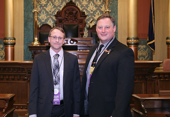 State Rep. Rep. Scott Dianda (D-Calumet) attends the 2018 State of the State address at the Michigan State Capitol on Tuesday, Jan. 23, 2018, with guest Steven Hillstrom, president and CEO of Xeratec.