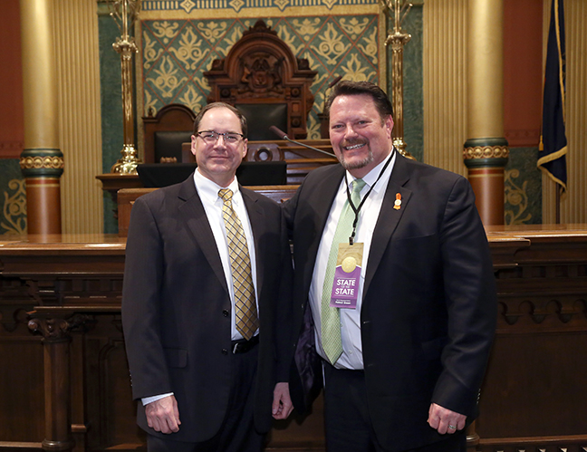 State Rep. Rep. Patrick Green (D-Warren) attends the 2018 State of the State address at the Michigan State Capitol on Tuesday, Jan. 23, 2018, with guest Dr. Paul Rogers, director of TARDEC.