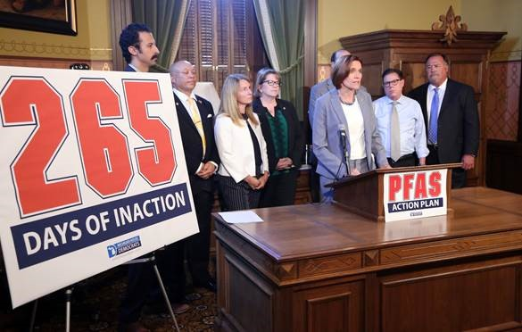 State Rep. Winnie Brinks (D-Grand Rapids) calls for immediate action on PFAS issues throughout the state. She is joined, from left to right, by state Reps. Yousef Rabhi (D-Ann Arbor), Sheldon Neeley (D-Flint), Donna Lasinski (D-Scio Township), Kevin Hertel (D-St. Clair Shores), Bill Sowerby (D-Clinton Township) and Tom Cochran (D-Mason). Directly behind stands House Democratic Floor Leader Christine Greig (D-Farmington Hills).