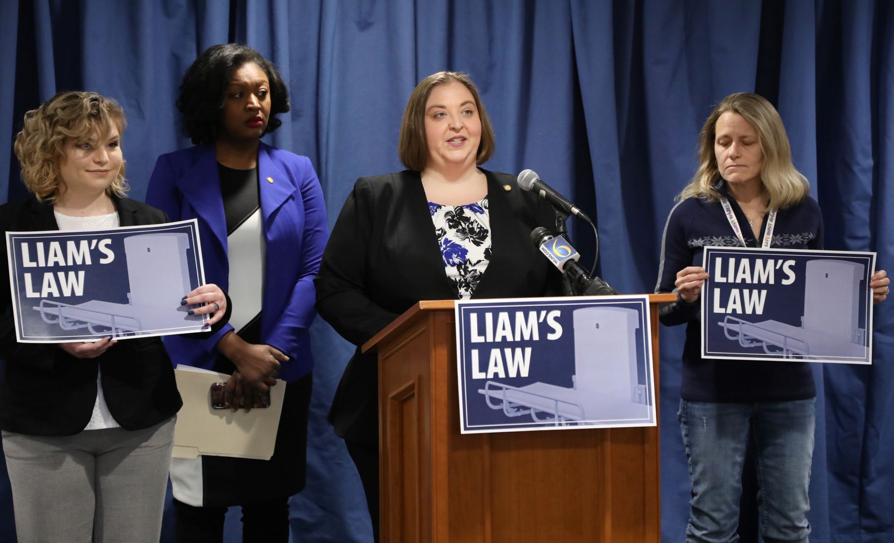 """State Rep. Lori Stone (D-Warren) unveiling """"Liam's Law"""" with State Rep. Sarah Anthony (D-Lansing); Jessica Gomez of Saginaw, Liam's mother (Left); and Amy Maes of Disability Network Oakland and Macomb (Right) at a press conference in Lansing on Thursday, Jan. 23, 2020 (Photo courtesy of House Democrats)."""