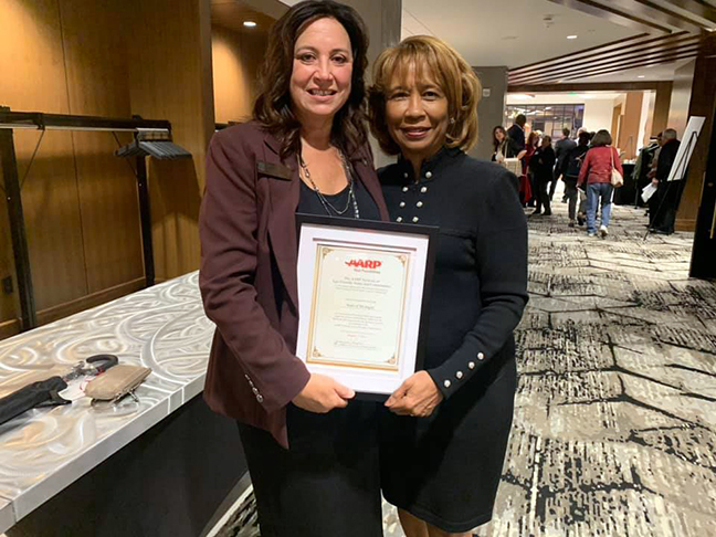 State Rep. Angela Witwer (D-Delta Township) with Paula Cunningham at the AARP Age Friendly Conference at Crowne Plaza Lansing West on October 7, 2019.