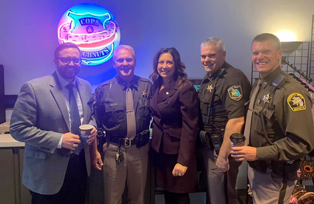 State Rep. Angela Witwer (D-Delta Township) at Cops & Donuts with Steve Japinga, of the Lansing Chamber of Commerce, and Capitol area sheriffs recently.