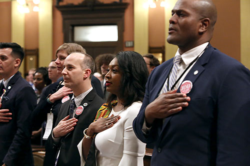 State Rep. Sarah Anthony (D-Lansing) joined by Lansing Mayor Andy Schor for Gov. Whitmer's first State of the State address in the Capitol in Lansing on Tuesday, Feb. 12, 2019