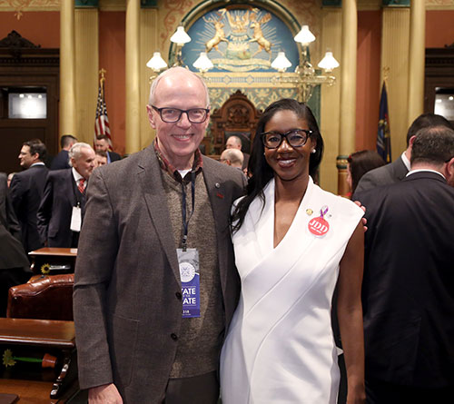 State Rep. Kyra Bolden (D-Southfield) joined by Southfield Mayor and former associate superintendent of Southfield Public Schools Kenson Siver for Gov. Whitmer's first State of the State address in the Capitol in Lansing on Tuesday, Feb. 12, 2019