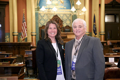 State Rep. Sara Cambensy (D-Marquette) joined by longtime Alger County community leader Joe Paquette for Gov. Whitmer's first State of the State address in the Capitol in Lansing on Tuesday, Feb. 12, 2019
