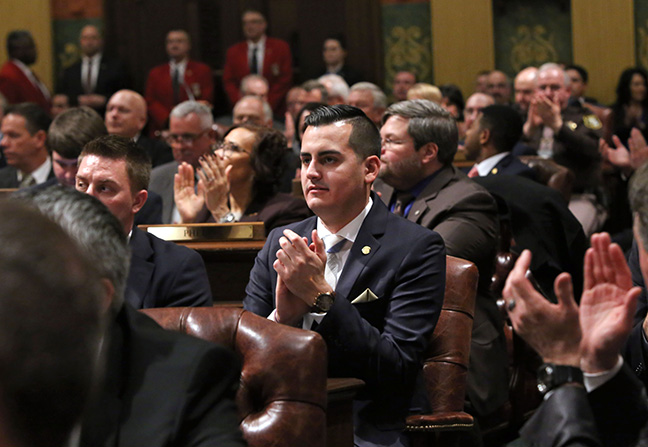 State Rep. Darrin Camilleri (D-Brownstown Twp.) applauds Michigan's veterans during Gov. Rick Snyder's State of the State address at the Capitol on Tuesday, Jan. 17, 2017.