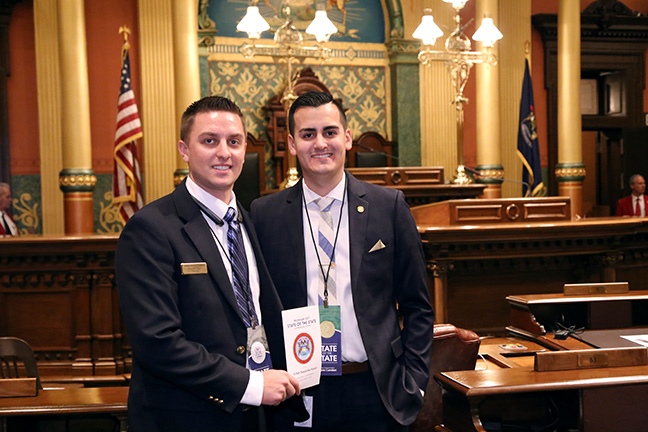 State Rep. Darrin Camilleri (D-Brownstown Township) stands with his guest, Huron Township Trustee Jeremy Cady, for Gov. Rick Snyder's State of the State address on Tuesday, Jan. 17, 2017, at the state Capitol in Lansing.