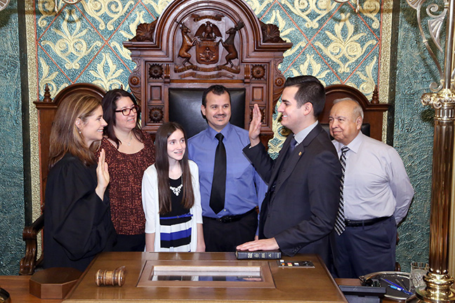 State Rep. Darrin Camilleri (D-Brownstown Township) takes the oath of office from Michigan Supreme Court Justice Bridget Mary McCormack on Wednesday, Jan. 11, 2017, at the state Capitol in Lansing. With him are his parents, Frank and Doreen Camilleri, his sister Alexa Camilleri and his grandfather Manuel Quiroz.