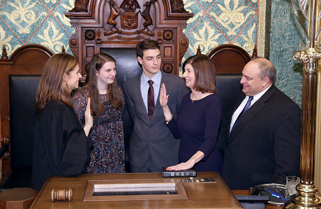 State Rep. Cara Clemente (D-Lincoln Park) takes the oath of office from Michigan Supreme Court Justice Bridget Mary McCormack on Wednesday, Jan. 11, 2017, at the state Capitol in Lansing. With her are her husband, former state Rep. Paul Clemente, their son Nathan Clemente and daughter Emma Clemente.
