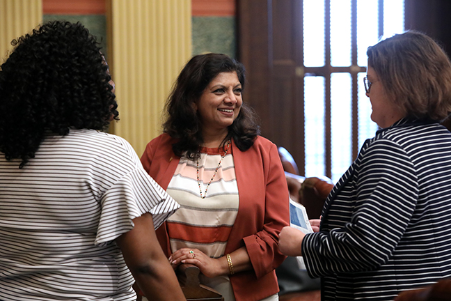 State Rep. Padma Kuppa (D-Troy) talks with colleagues on the House floor Tuesday, August 27, 2019.