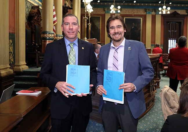 State Rep. Nate Shannon (D-Sterling Heights), with state Rep. Brad Paquette (R-Niles), introduced House bills 5165-6 as part of a bipartisan package to help uplift teachers in communities who go above and beyond for their students, on Thursday, October 24, 2019. The package would create the 'Made a Difference Teacher Fund', which Michigan residents could voluntarily contribute to when filing their annual tax returns. Residents would also be able to nominate a teacher that made a difference in their lives or the lives of others to receive a monetary award from the fund.