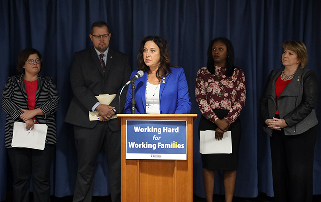 State Rep. Angela Witwer (D-Delta Township) and House Democrats announced legislation to reduce the undue strain many families in the state are facing due to job insecurity, stagnant wages and rising costs, at a press conference Monday, September 23, 2019.
