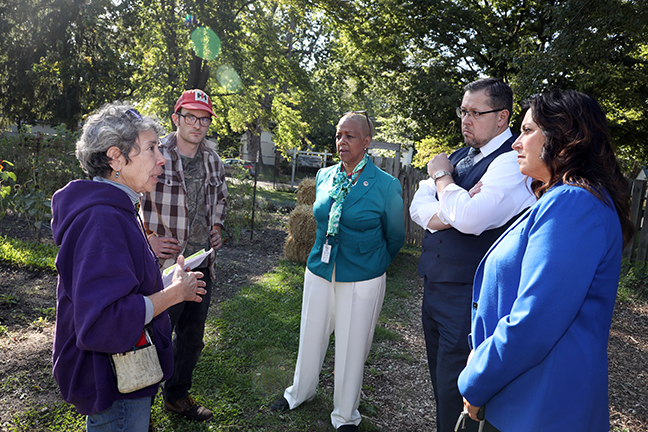House Committee on Agriculture members Brian Elder (D-Bay City), Cynthia A. Johnson (D-Detroit) and Angela Witwer (D-Delta Township) on a tour of Urbandale Farm in Lansing with Laura DeLind, director of the Lansing Urban Farm Project, on Tuesday, October 8, 2019.