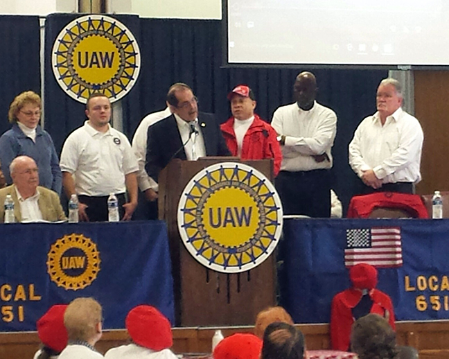 State Rep. Tim Sneller (D-Burton) speaks to the crowd, and presents House Resolution 246, at the UAW 651 White Shirt Day Celebration, on February 9, 2018.