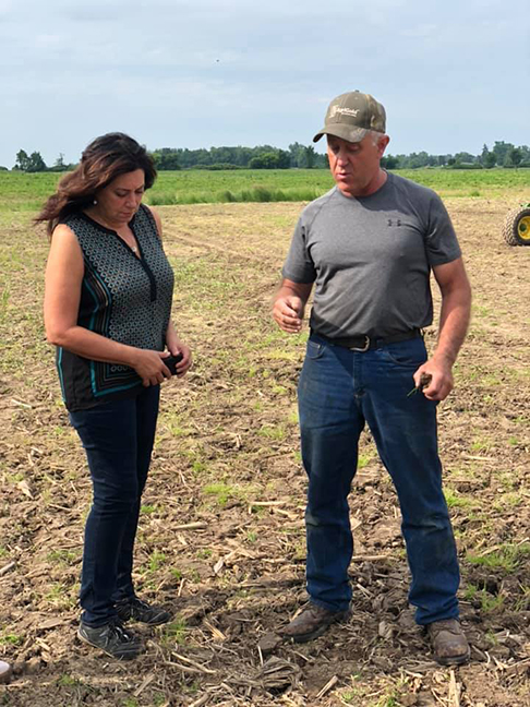 State Rep. Angela Witwer (D-Delta Township) talked with Gary Parr during her visit was to Parr Farms in Charlotte over the summer to see firsthand the devastation to Michigan soybean crops caused by the historically wet spring.
