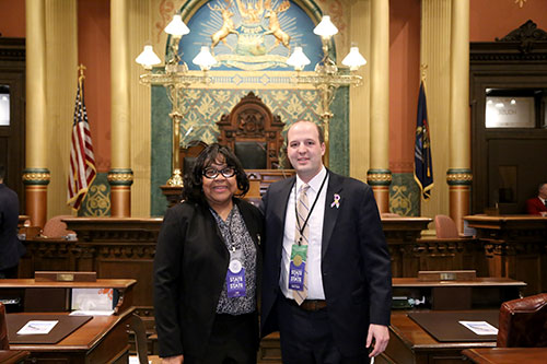 State Rep. Kevin Hertel (D-St. Clair Shores) joined by community activist and educator Mary Hall-Rayford for Gov. Whitmer's first State of the State address in the Capitol in Lansing on Feb. 12, 2019.