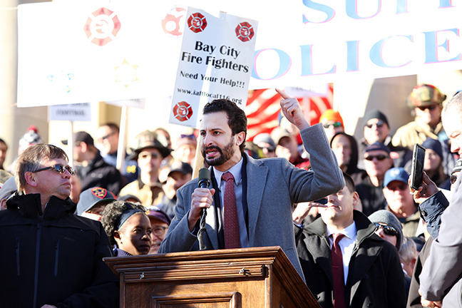 State Rep. Yousef Rabhi (D-Ann Arbor) speaks at a Capitol rally to protect police and firefighter pensions, Wednesday, Nov. 29, 2017.