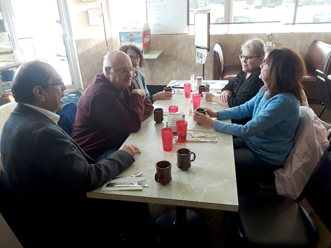 Rep. Tim Sneller (D-Burton) meets with constituents at his in-district coffee hour at Scotti's Coney Island in Burton, on February 1, 2019.