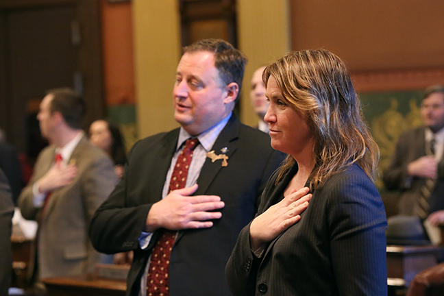 State Rep. Sara Cambensy (D-Marquette) takes the Pledge of Allegiance to start session during her first week as a representative, Wednesday, November 29, 2017.