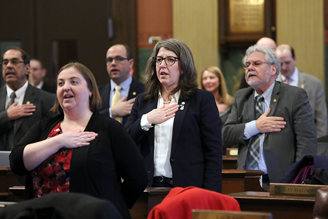 State Rep. Rachel Hood (D-Grand Rapids) takes the Pledge of Allegiance before session on Tuesday, January 29, 2019.