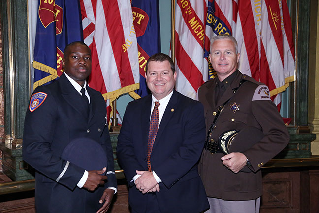 State Rep. Terry Sabo (D-Muskegon) with Muskegon County Sheriff Michael Poulin and Muskegon firefighter Lt. Fonte' Love at the Capitol for the 9/11 Memorial Ceremony on Thursday, Sept. 7, 2017.