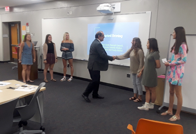 State Rep. Tim Sneller (D-Burton) participates in Mr. Riek's AP Government and American Government classes at Grand Blanc High School on June 3, 2019.