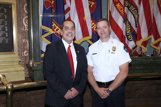 State Rep. Tim Sneller (D-Burton) hosted Burton Chief of Police Thomas Osterholzer during the annual 9/11 Memorial Ceremony on September 7, 2017.