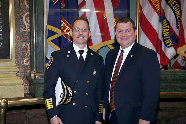 State Rep. Terry Sabo (D-Muskegon) with Muskegon Township Fire Chief David Glotzbach at the Capitol for the 9/11 Memorial Ceremony on Thursday, Sept. 7, 2017.