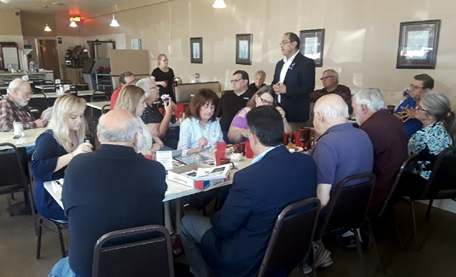 State Rep. Tim Sneller (D-Burton) discusses transportation and infrastructure issues at his coffee hour at Scotti's Coney Island in Burton on June 7, 2019. He was joined by his special guest Tony Kratofil, MDOT Chief Engineer and Chief Operations Officer.