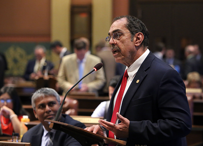 State Rep. Tim Sneller (D-Burton) explains House Bill 4573 on the House floor, a bill he introduced to establish and authorize a special assessment district for mosquito abatement, on October 5, 2017.