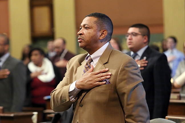 State Rep. Tyrone Carter (D-Detroit) takes the Pledge of Allegiance at the start of session on Tuesday, February 5, 2019.