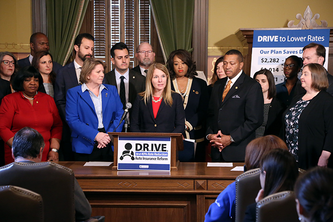 State Rep. Donna Lasinski (D-Scio Township) and House Democrats outlined an auto insurance reform plan that will lower insurance rates by forty percent without reducing accident coverage, at a Capitol press conference Thursday, May 16, 2019. The D.R.I.V.E. plan delivers the first holistic approach to Michigan's auto insurance system by Delivering Reduced Insurance Rates and Value to Every Michigander. Michigan's auto insurance industry is one of the least regulated in the U.S. with Michigan drivers paying nearly two times more than drivers anywhere else in the nation, according to a University of Michigan study. Democrats' D.R.I.V.E. plan tackles those rates head-on by requiring a forty percent rate reduction on the total bill, increasing consumer protections and ending discriminatory rate-setting practices like red-lining.