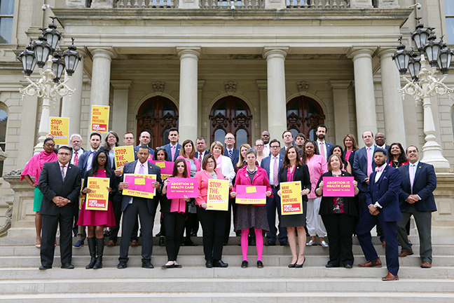 State Rep. Julie Brixie (D-Meridian Township) with her House Democratic colleagues at the Capitol standing against national anti-choice legislation on Tuesday, May 21, 2019.