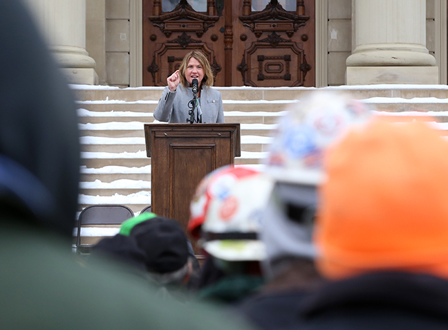 State Rep. Sara Cambensy (D-Marquette) speaks to workers in support of Michigan's prevailing wage laws at a rally at the Capitol in Lansing on Wednesday, Jan. 10, 2018.