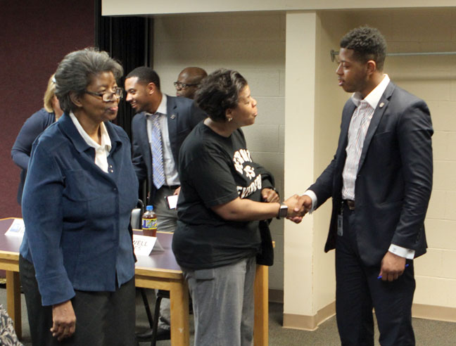 State Rep. Jewell Jones (D-Inkster) speaks with a constituent following a town hall meeting on Monday, April 24, 2017, at the Maplewood Community Center in Garden City.