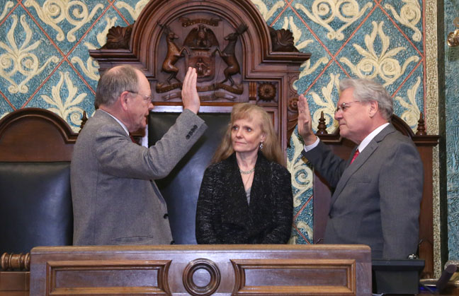With his wife Jodie looking on, newly-elected State Rep. Jim Ellison (D-Royal Oak) was sworn in by House Clerk Gary Randall on Friday, Dec. 16, 2016.