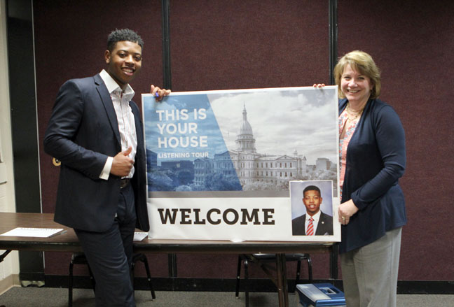State Rep. Jewell Jones (D-Inkster) and House Democratic Floor Leader Rep. Christine Greig (D-Farmington Hills) pose with the welcome sign before a town hall meeting on Monday, April 24, 2017, at the Maplewood Community Center in Garden City.