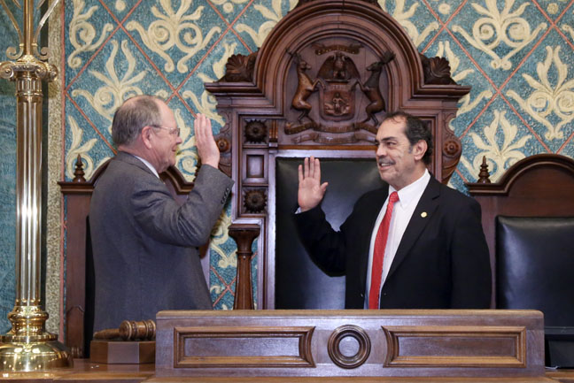 State Rep. Tim Sneller (D-Burton) was sworn in by House Clerk Gary Randall on Wednesday, Dec. 21, 2016.