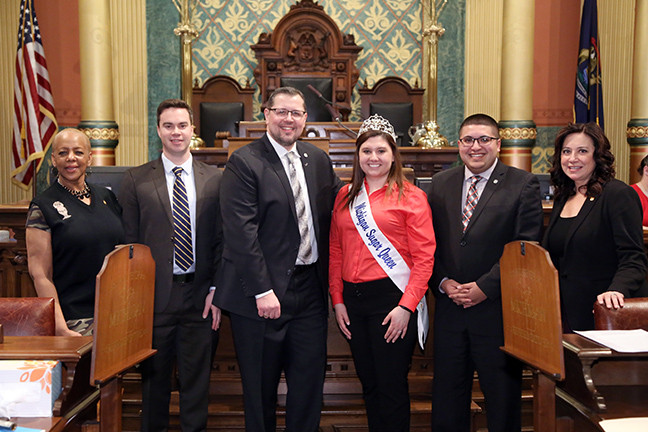Members of the House Committee on Agriculture welcomed 2018 Michigan Sugar Queen Paige Lupcke, of Saginaw, to the House floor on Wednesday, February 13, 2019. Committee members include Cynthia A. Johnson (D-Detroit), Kevin Coleman (D-Westland), Brian Elder (D-Bay City), Alex Garza (D-Taylor) and Angela Witwer (D-Delta Township).