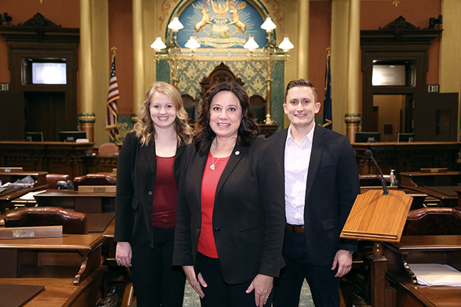 State Rep. Angela Witwer (D-Delta Township) with her legislative staff, Joseph Fedewa and Chelsea Fraley.