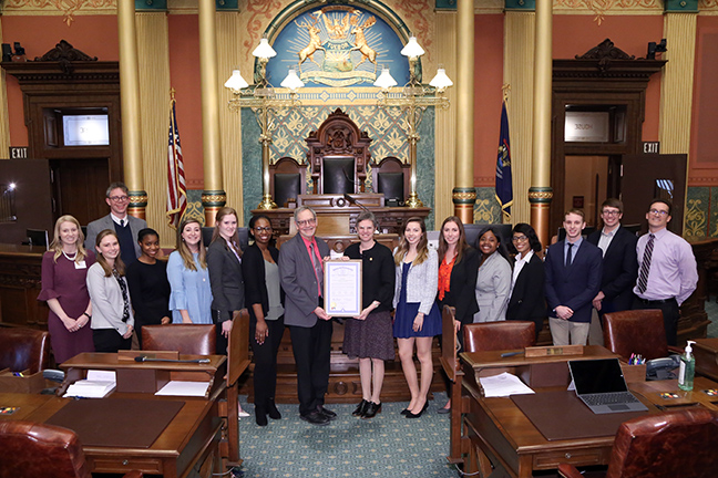 "State Rep. Julie Brixie (D-Meridian Township) presented tributes on the House floor to this year's participants of the Political Science Scholarship Program from Michigan State University, on Wednesday, April 17, 2019. Each year, only about 20 students are selected for this exclusive program, based on nominations by their professors, academic excellence, and potential for a future career in political science, law or the public sector. This competitive and prestigious program offers several benefits to participants to advance their career goals, including a ""Day at the Capitol"" immersive learning experience."