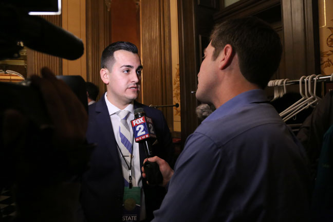 State Rep. Darrin Camilleri (D-Brownstown Twp.) talks with the media after Governor Snyder's State of the State address Tuesday, Jan. 17, 2017.