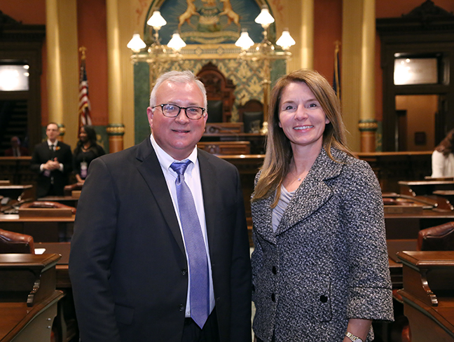 State Rep. Donna Lasinski (D-Scio Township) attends Gov. Rick Snyder's eighth State of the State address with special guest Tim Hutchins of IBEW Local 252, on Tuesday, Jan. 23, 2018, at the state Capitol in Lansing.