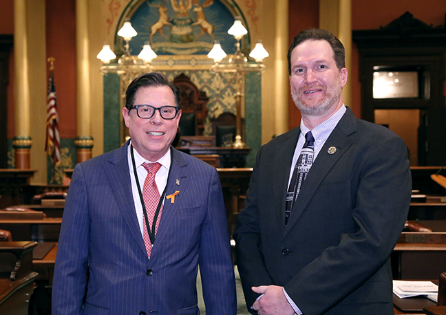 State Rep. Bill Sowerby (D-Clinton Township) attends the 2018 State of the State address at the Michigan State Capitol on Tuesday, Jan. 23, 2018, with guest Andy Ell-Bernard Dunbar of IBEW Local 58
