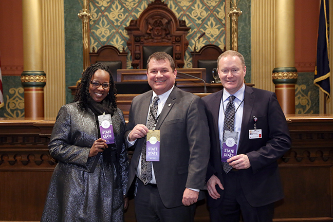 State Rep. Rep. Terry Sabo (D-Muskegon) attends the 2018 State of the State address at the Michigan State Capitol on Tuesday, Jan. 23, 2018, with guests Muskegon Heights Mayor Kimberly Sims and Gary Allore, president of Mercy Health Muskegon.