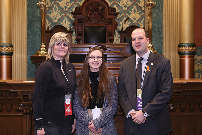 State Rep. Kevin Hertel (D-St. Clair Shores) attends the 2018 State of the State address at the Michigan State Capitol on Tuesday, Jan. 23, 2018, with guests Madison Horton and her mother, Laura Horton.