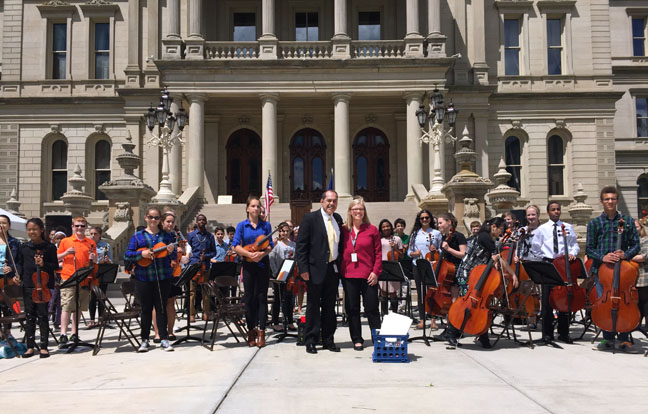 State Rep. Tim Sneller (D-Burton) met with members of the Grand Blanc Middle School Orchestra in front of the state Capitol on May 31, 2017.