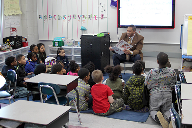 State Rep. Tyrone Carter (D-Detroit) read to students at Ralph J. Bunche School in Ecorse in celebration of March is Reading Month on March 25, 2019.