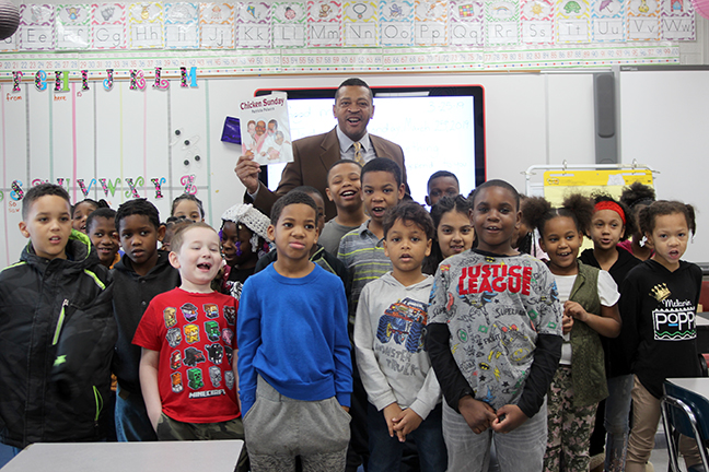 State Rep. Tyrone Carter (D-Detroit) reads to students at Ralph J. Bunche School in Ecorse in celebration of March is Reading Month on March 25, 2019.